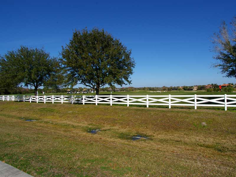 Cross buck post and rail vinyl horse fence